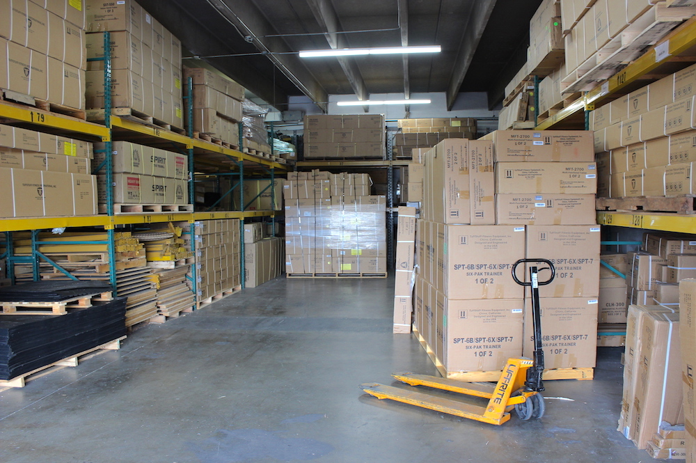 Fitness Gallery keeps a large supply of exercise equipment in inventory